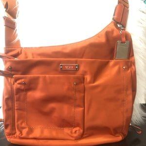 Orange Tumi Crossover bag